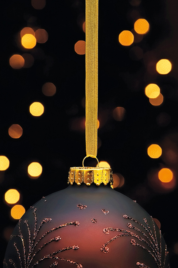 Close up shot of a Copper Colour Christmas tree Bauble on a Dark background,